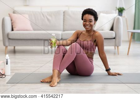 Black Lady Holding Water Bottle Hydrating During Training At Home