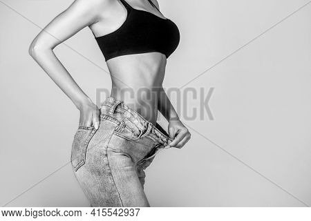 Weight Loss Concept. Thin Woman In Big Pants, Weight Loss Concepts. Slim Girl Wearing Oversized Pant