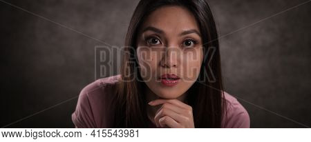Young Girl With Astonished Facial Expression - Studio Photography