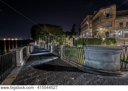 Syracuse Sicily/ Italy - December 28 2019: Source Aretusa In The Night And The Alfeo Seafront