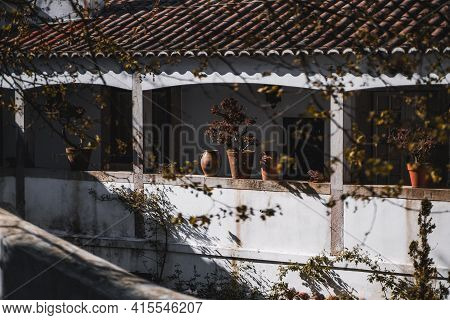 A Facade Of An Old Antique Stone Residential House Lit By The Bright Afternoon Sun With Contrast A P