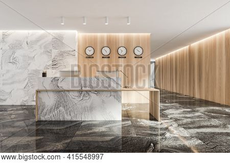 Marble And Wooden Reception Interior Room With Two Computers, Clocks On The Wall. Reception Entrance