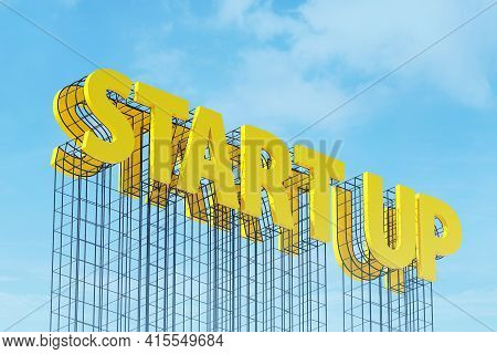Large Yellow Signboard On Metal Frame With The Word Start Up. Clear Sky In The Background. Concept O