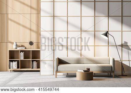 Waiting Room Interior With Comfortable Couch, Lamp, Paper Partition, Bookcase, Concrete Floor, Bookc