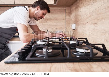 Plumber Signs A Contract For The Services In The Kitchen