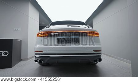 Germany, Berlin - March 2021: Rear View Of New Car At Car Dealership. Action. Stylish Rear View Desi