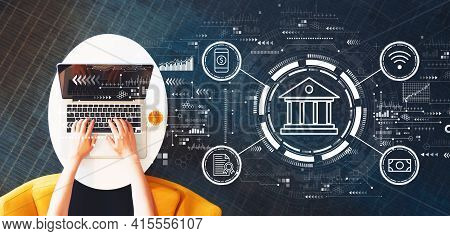 Online Banking Concept With Person Using A Laptop On A White Table