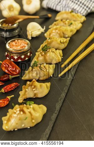 Fried Dumplings Gyoza With Soy Sauce, And Chili. Chinese Dumplings Stuffed With Meat. Homemade Meat