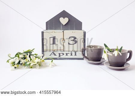 Calendar For April 13: Cubes With The Number 13, The Name Of The Month In English, Two Gray Coffee C