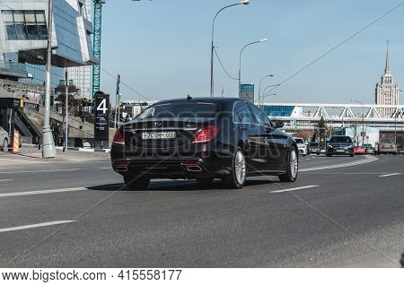 Moscow , Russia - March 2021: Mercedes-benz S500 On The City Road. Back View Of Black Shiny Car On T