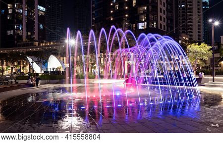 1st December 2020.colorful Fountains At Dubai Creek Harbor With Embankment Promenade ,hotels, Shops
