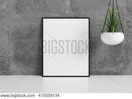 Single 8x10 Vertical Black Frame Mockup With Green Plant In Vase On White Floor And Concrete Wall. 3