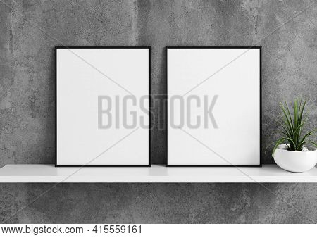 Double 8x10 Vertical Black Frame Mockup With Green Plant In Vase On White Shelf And Concrete Wall. 3