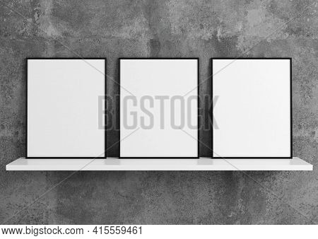 Triple 8x10 Vertical Black Frame Mockup On White Shelf And Concrete Wall. 3d Rendering