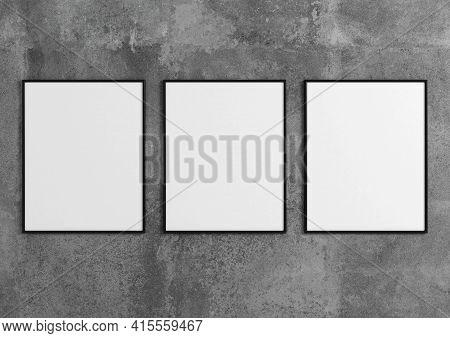 Triple 8x10 Vertical Black Frame Mockup On Concrete Wall. 3d Rendering