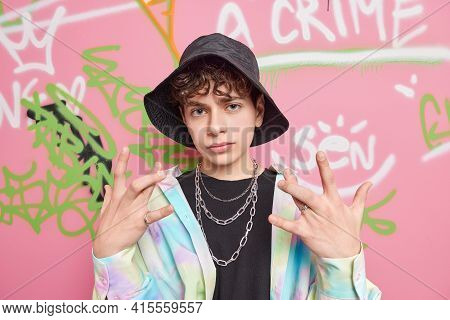 Urban Lifestyle Concept. Cool Youngster With Curly Hair Crosses Fingers Gestures Actively Wears Blac