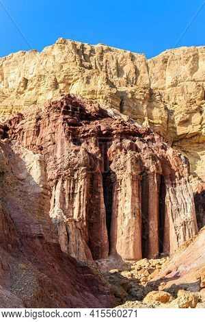 The Pillars of Amram. Israel. Multicolored landscape formations. Bizarre forms of weathered sandstone in the Eilat Mountains. The rocks are composed of sandstones and volcanic rocks.