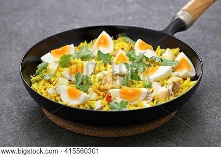 Kedgeree; spice rice with smoked haddock nad boiled eggs, homemade english breakfast