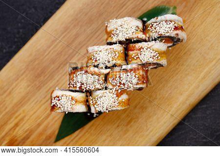 Seafood Delicatessen Unagi Sushi Rolls On Board