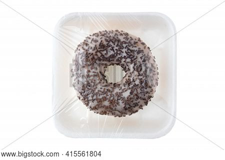 Donut Close-up On A White Background. Round Donut In Packaging Close-up.