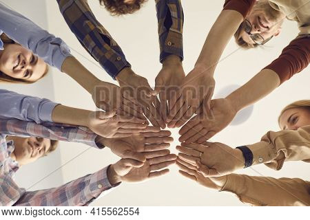 Close Up Bottom View Of People Putting Hands Together Standing In Circle