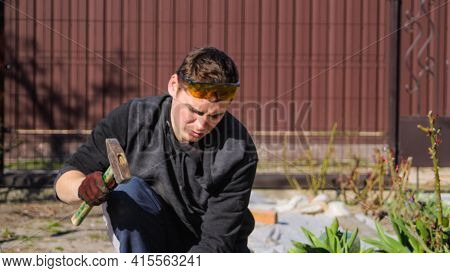 Defocus Young Construction Worker In Yellow Glasses Wrinkled Forehead Removing Irregularities On Flo