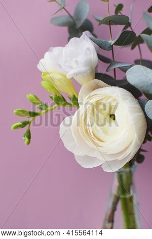Delicate Bouquet Of Delicate Pink Ranunculus Flower And White Freesia With Eucalyptus Sprigs On A Pi