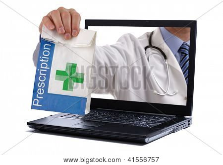 Internet drug store concept doctor holding prescription medicine through a laptop screen