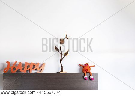 Detail Of Decoration With The Message Of Happy A Wooden Flower And A Funny Orange Stuffed Cow With F