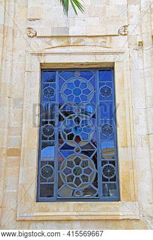 Decorative Stained-glass Window On The Church Of Ayios Titos Near August 25th Street In Heraklion, C