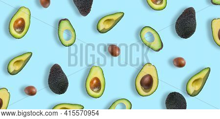 Pattern Of Fresh Ripe Green Avocados. Avocado Banner. Avocado Pieces And Halves Isolated On A Blue B