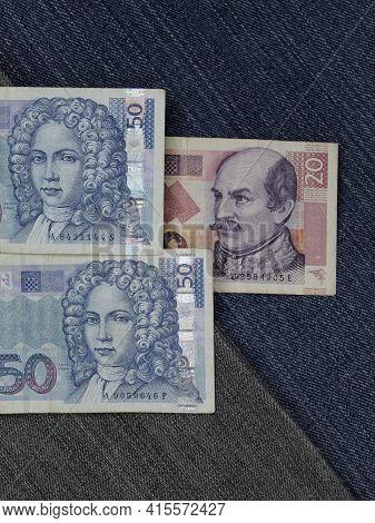 Stacked Croatian Banknotes Between Blue Denim Fabric