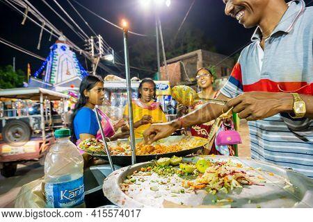 Howrah, West Bengal, India - April 14th 2019 : Happy Street Vendor Serving Chotpoti , A Roadside Ind