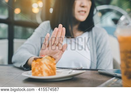 Hands Woman Refusing Cake Or Junk Food In Restaurant,no Meal,diet Food Concept