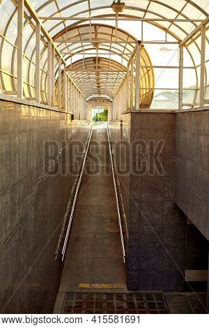 Modern Underground Passage. The Walls And Floor Of The Passage Are Decorated With Granite.