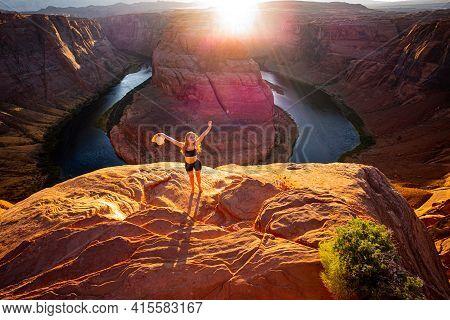 Young Woman Enjoying View Of Horseshoe Bend, Arizona. Arizona Horseshoe Bend In Grand Canyon. Travel