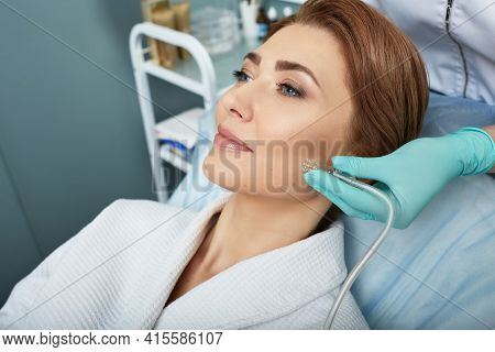 Facial Ozone Therapy For Womans Face Rejuvenation At A Beauty Salon. Oxygen Treatment For Skin