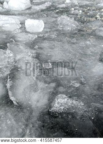 Abstract Winter Nature Background. Top View Of Ice Drift. Ice Floes Of Different Sizes Floats On The