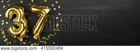 Golden Foil Balloon Number Thirty Seven. Birthday Or Anniversary Card With The Inscription 37. Black