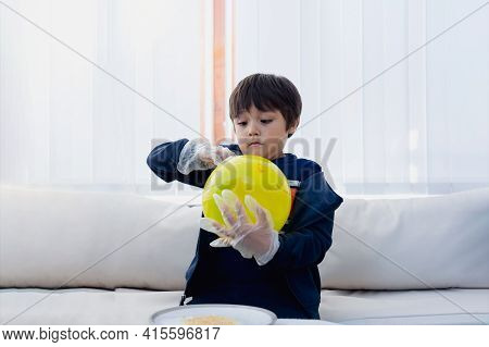 Cute Boy Wearing Disposable Protective Plastic Glove And Holding Yellow Balloon,kid Preparing Scienc