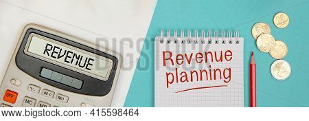 Write Revenue On A Calculator. Revenue Planning Is Written On A Blank Note. Business Concept.