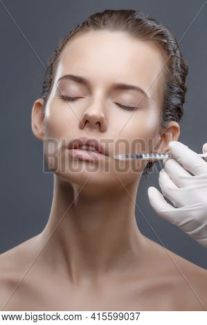 The Doctor Cosmetologist Makes The Rejuvenating Facial Injections Procedure For Tightening And Smoot
