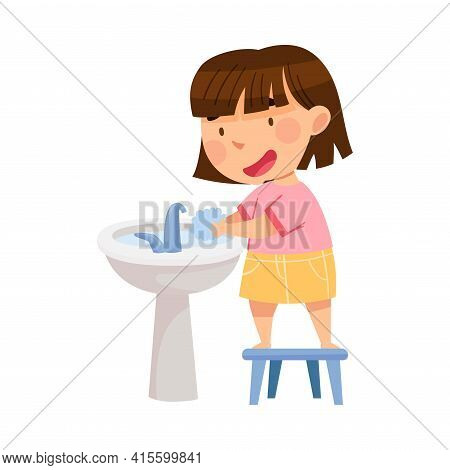 Cute Girl Standing On Stool Near Wash Stand Washing Her Hands With Soap Engaged In Personal Hygiene
