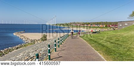 Urk, Netherlands - April 22, 2020: Panorama Of The Bicycle Path On The Dike In Urk, Netherlands