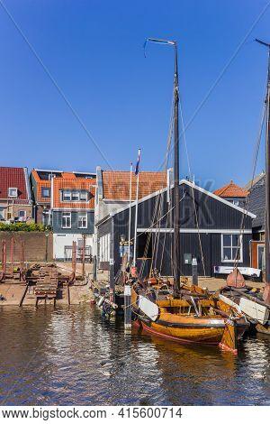 Urk, Netherlands - April 22, 2020: Traditional Wooden Sailing Ships At The Shipyard In Urk, Netherla