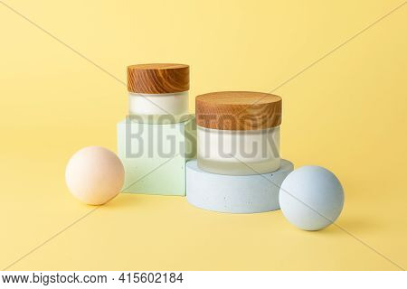 Two Skin Care Packaging Boxes With White Cream,staying On The Geometrical Podiums.pastel Background,