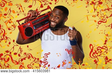 Man Ears The Music With An Old Stereo And Dances. Emotional And Energetic Expression. Yellow Backgro