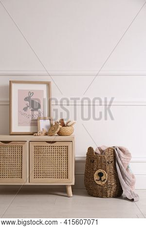 Modern Child Room Interior With Wooden Cabinet And Different Accessories. Space For Text