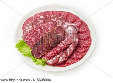 Sliced Cured And Smoked Sausages Of Different Types, Dry-cured Pork Tenderloin On White Dish On A Wh
