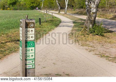 Salland, Netherlands - April 27, 2020: Direction Sign For Bicycle Tracks In National Park Sallandse